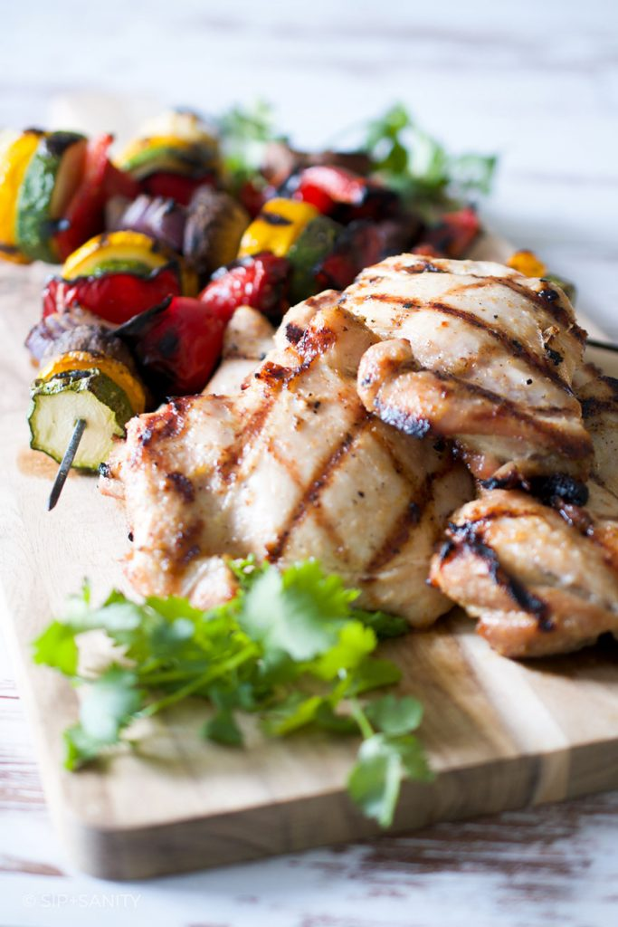 grilled vegetables and chicken on a cutting board