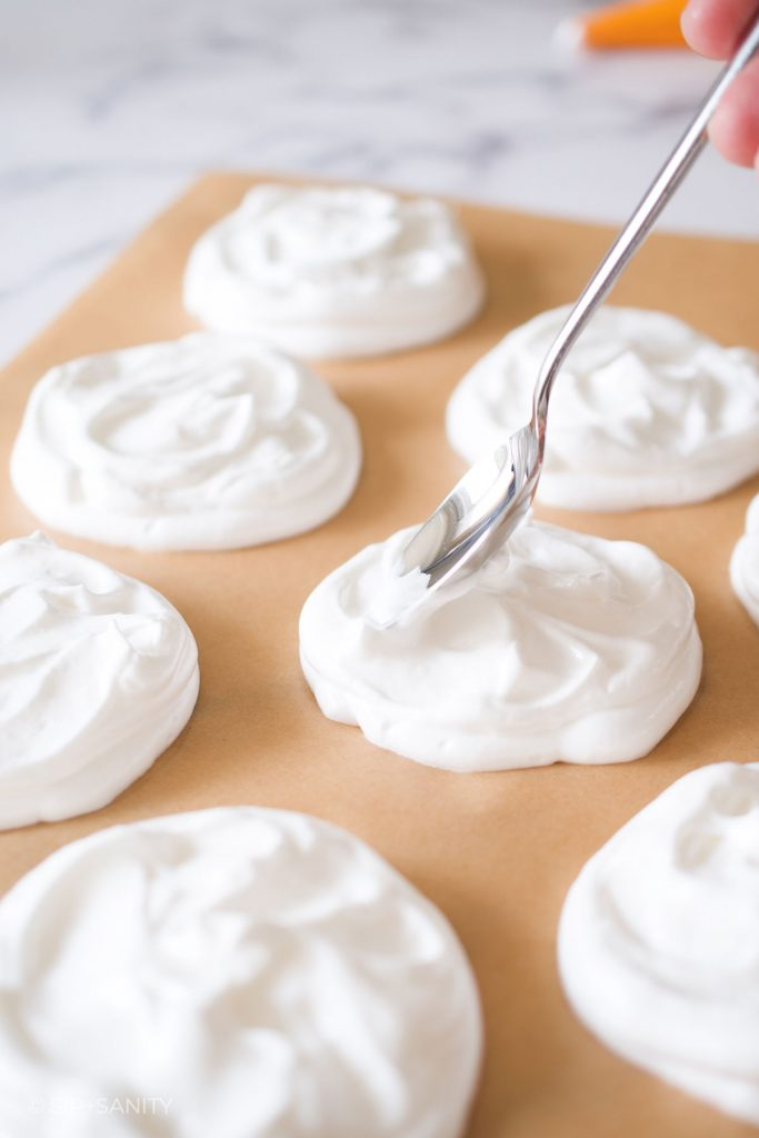 smoothing meringue with a spoon