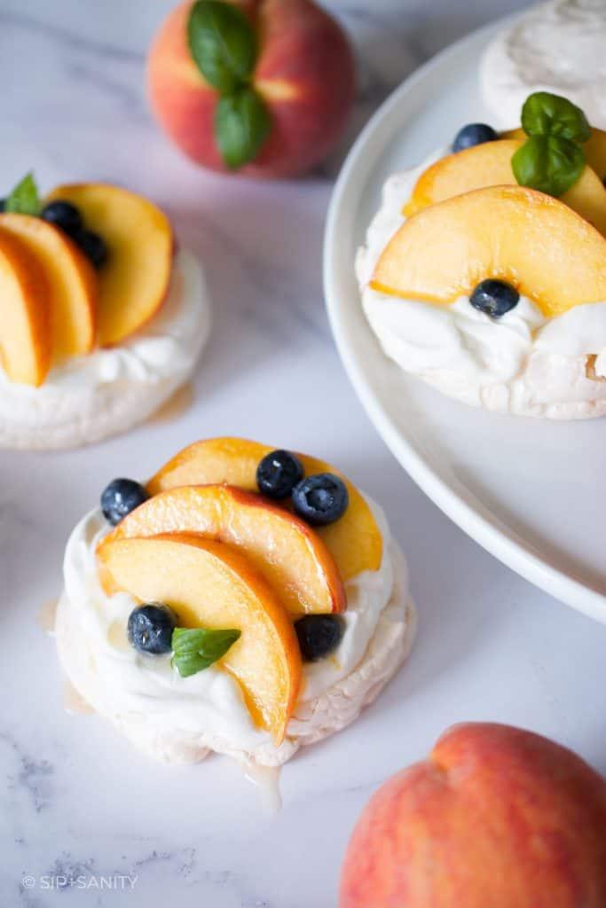 cake stand and mini peach pavlovas