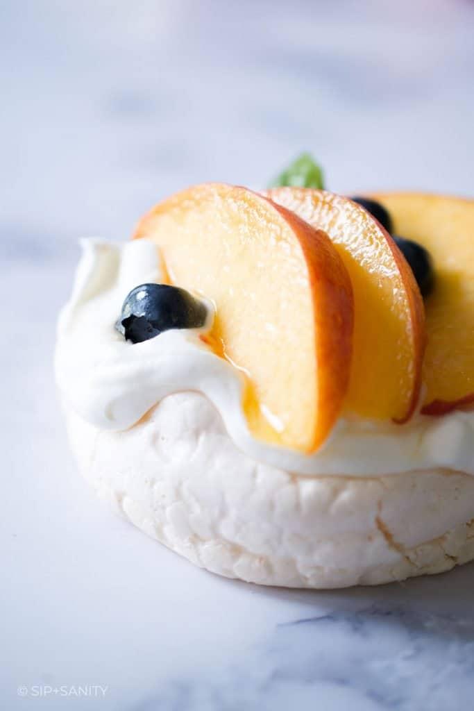 mini fresh peach pavlova with fuzzy navel syrup