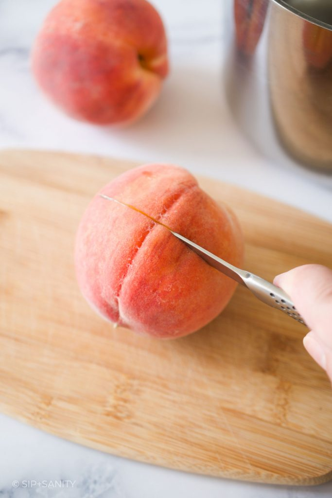 slicing a peach around its equator