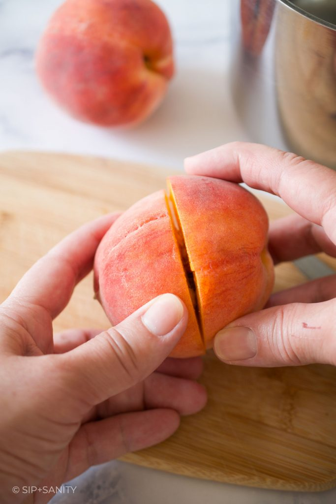 twisting a peach off the pit