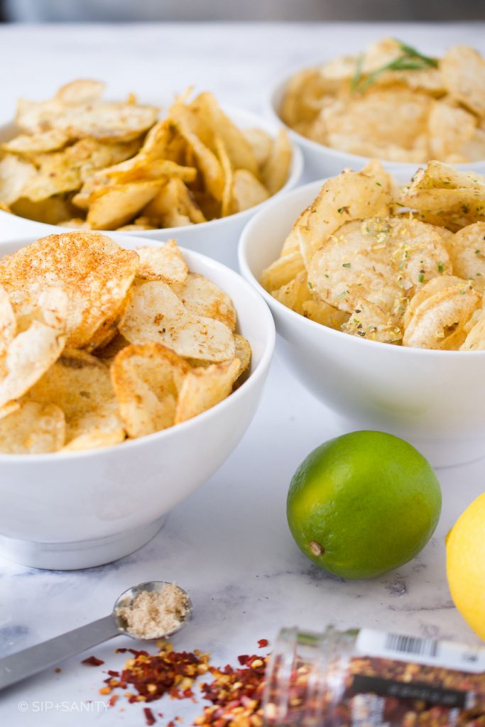 four bowls of chips with raw ingredients
