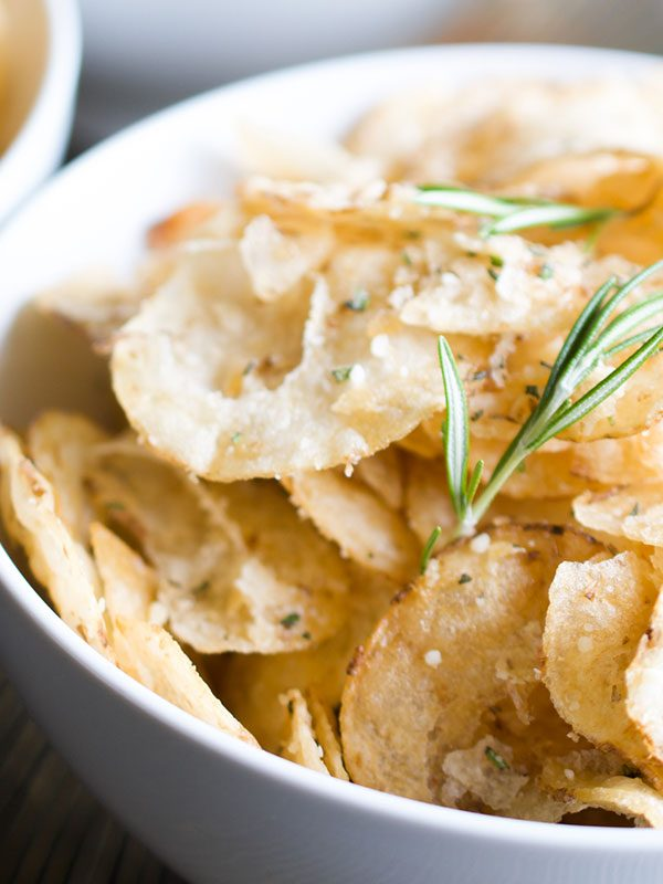 a bowl of rosemary parmesan kettle potato chips