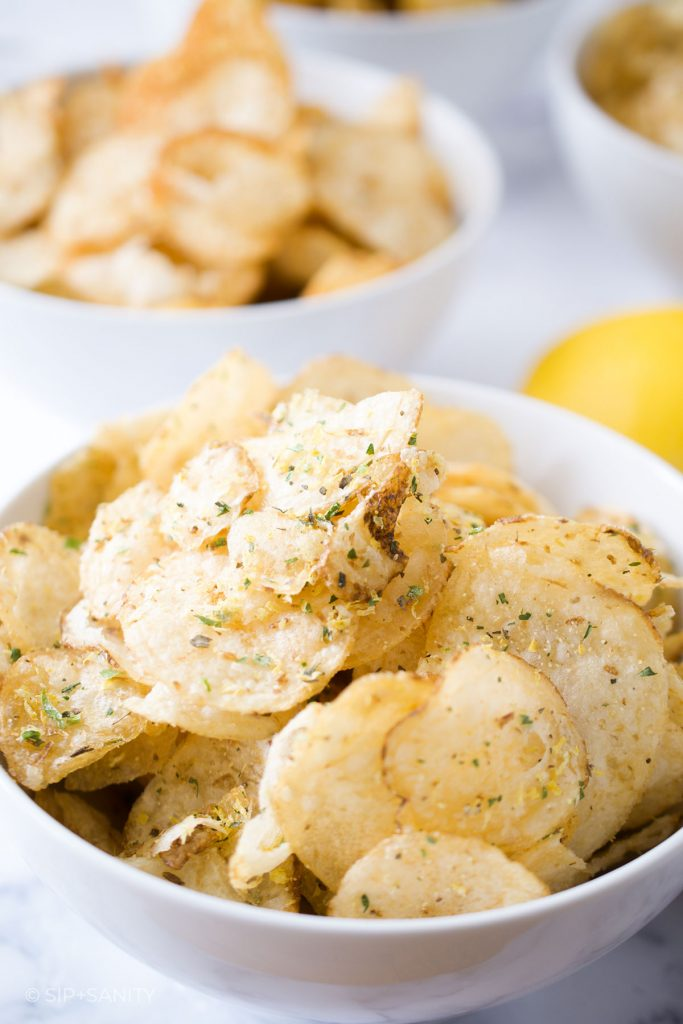 a bowl of lemon and herb seasoned chips
