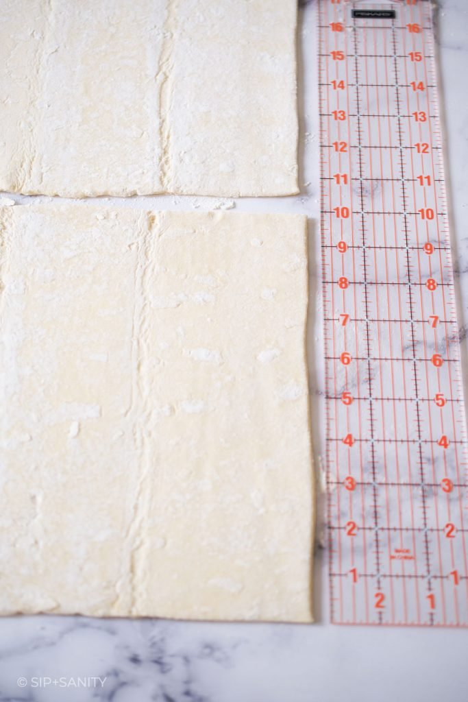 a ruler next to a sheet of puff pastry