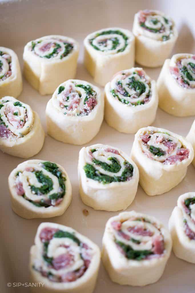 precooked prosciutto parm rolls in a baking dish
