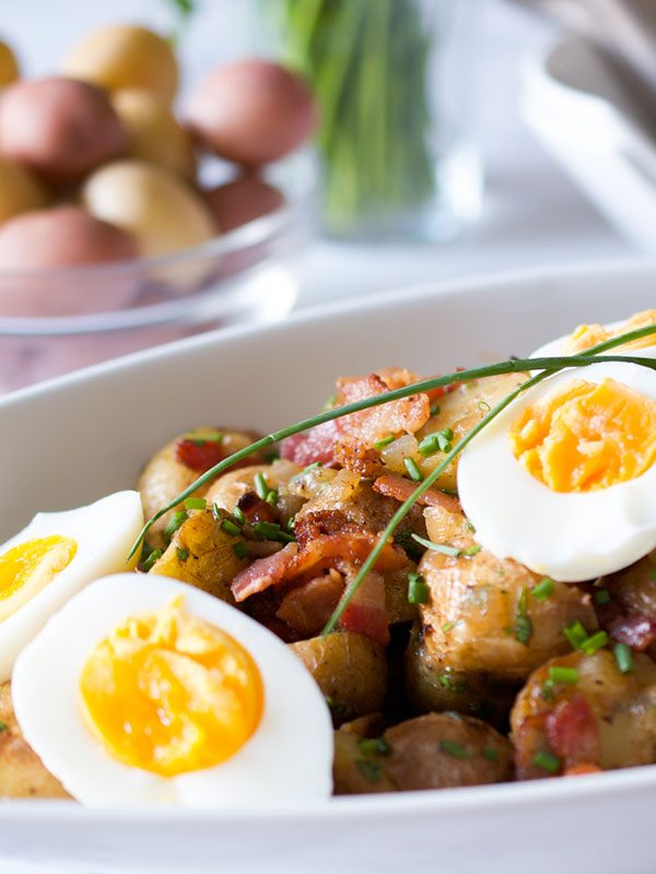 German style potato salad with baby potatoes in the background