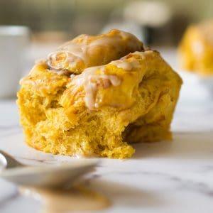 a single pumpkin spice latte sweet roll on a table
