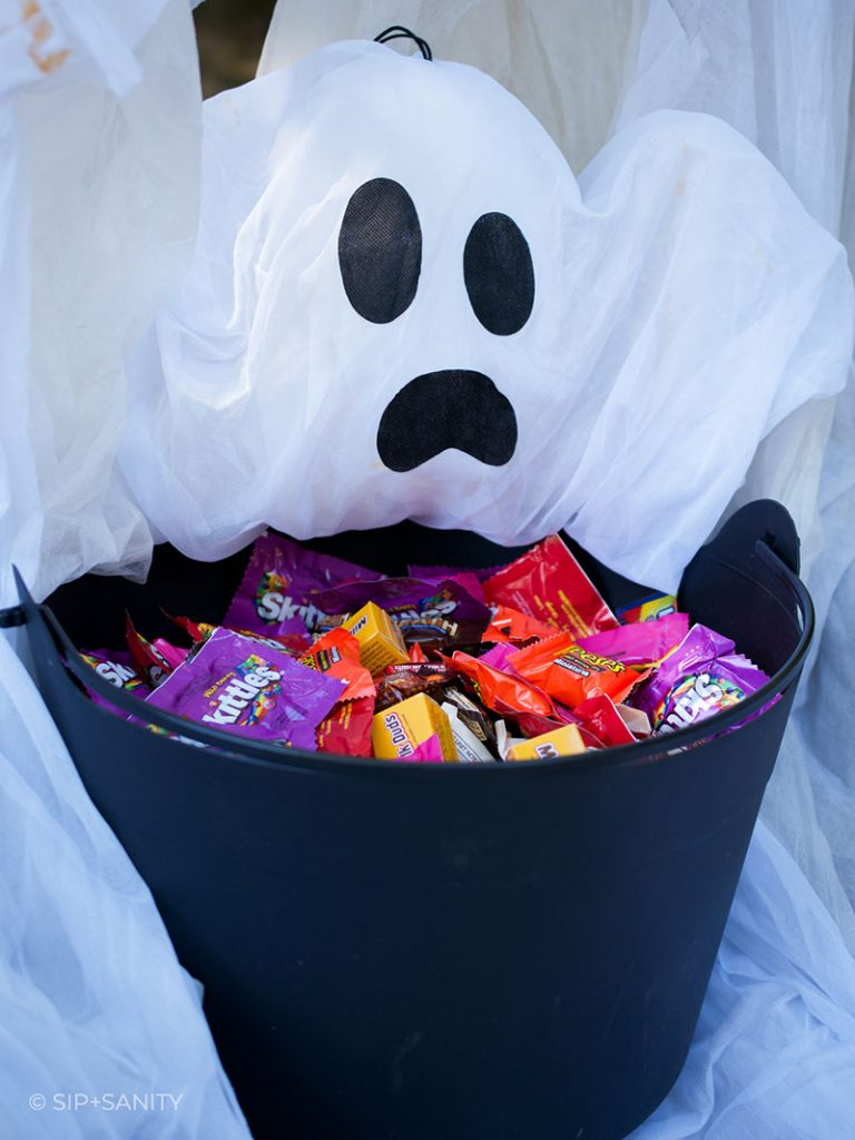 closeup of a ghost hovering over a bowl of candy