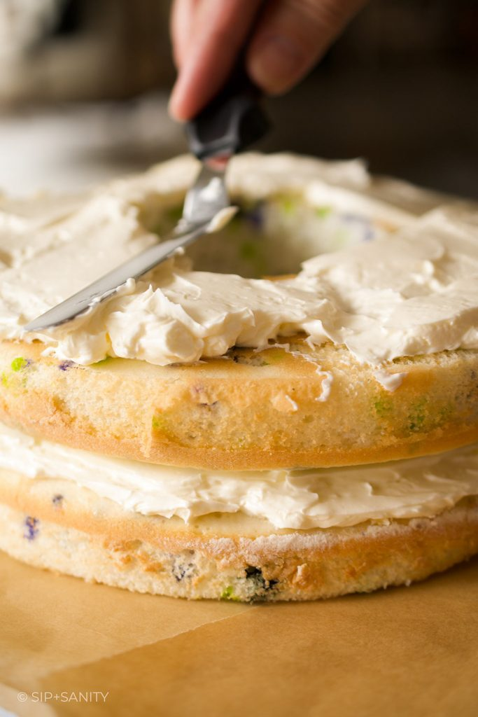 spreading icing over a cake layer