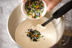 adding sprinkles to cake batter