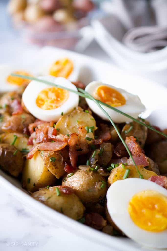 serving dish of air fryer german potato salad