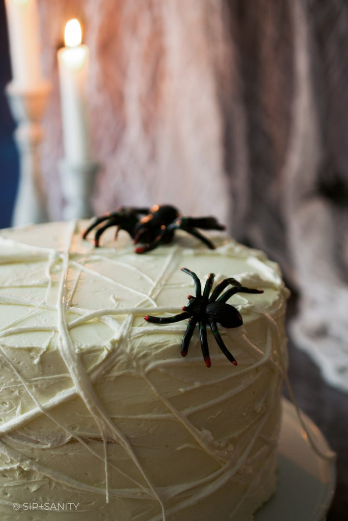 spiderweb cake with spiders on top