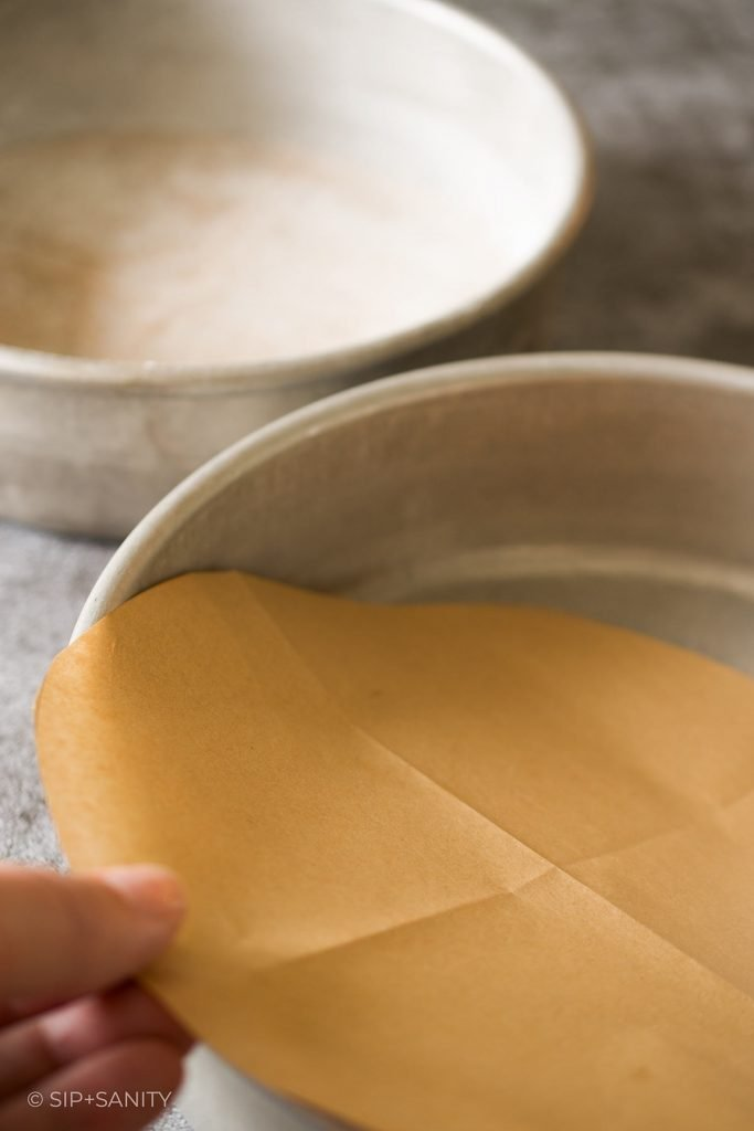 setting a parchment circle in a cake pan