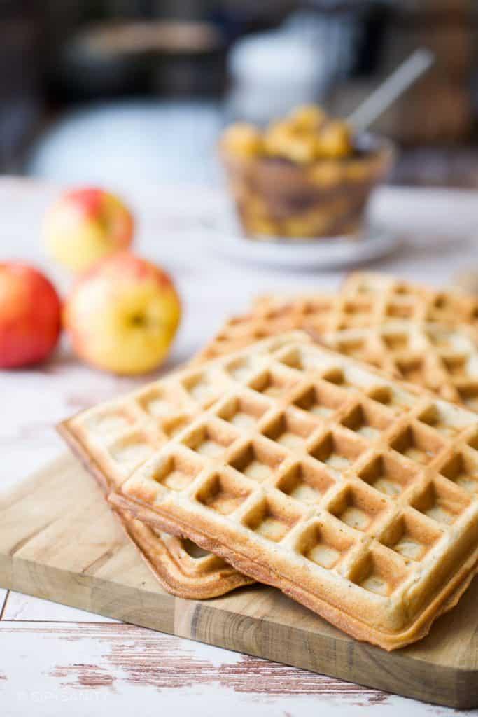 spiced apple waffles arranged on a board