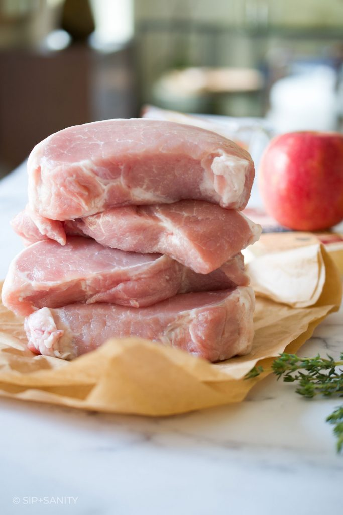 thick cut pork chops in a stack of four